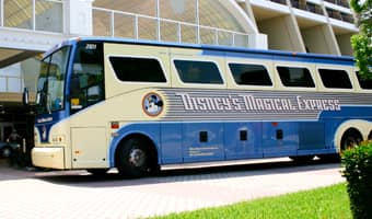 Disney's Magical Express bus parked outside Disney's Contemporary Resort