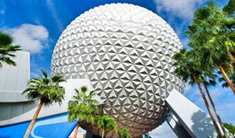 Palm trees in front of Spaceship Earth at Epcot