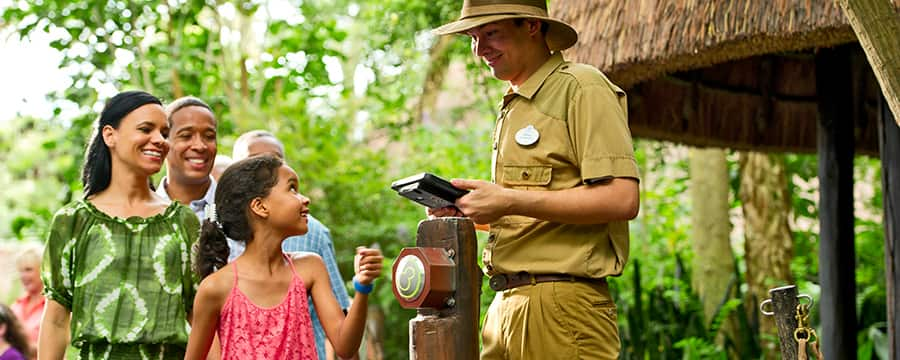 A family enjoys the ease of using MagicBands to get on Jungle Cruise attraction.
