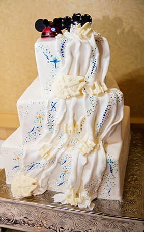 Wedding cake wednesday star wars galaxy inspiration disney weddings in the grooms personality and the custom mickey ear cake topper adds a little disney flair to perfectly complement this disneys fairy tale wedding junglespirit Choice Image