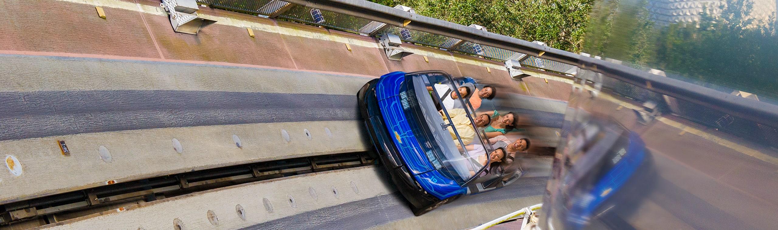A family smiles on a roller coaster