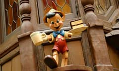 Wooden Pinocchio with a Mug and Plat of Cake in Hand at Village Haus Restaurant, hosted by Minute Maid