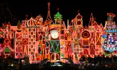 Adults and Children in Front of Sleeping Beauty Castle Lit Up for the Holidays