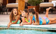 Girls play together at a Disneyland Resort Hotel pool.