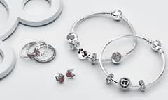 Disney-themed rings, earrings, and bracelets with beads.