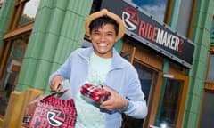 Man Holding a Model Car in Front of RIDEMAKERZ