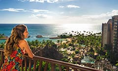 Aulani woman on balcony ovelooking beach
