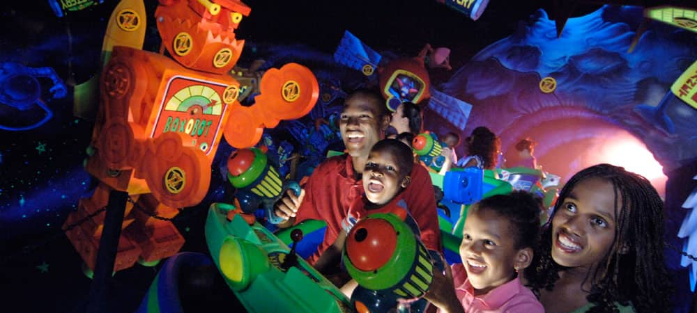 Family Blasting Targets at Buzz Lightyear Astro Blasters