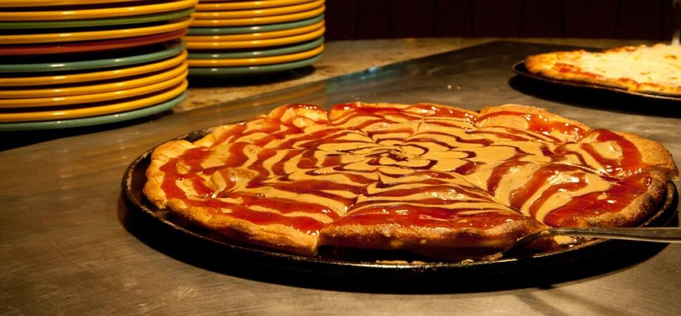 Este platillo es la especialidad de Goofy: mantequilla de cacahuate y dulce de jalea hechas remolino sobre un bizcocho.