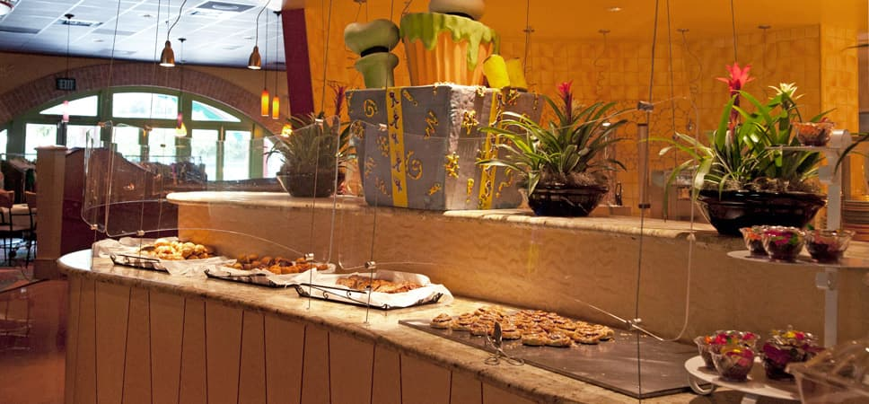 Trays of sweet treats along the buffet line.
