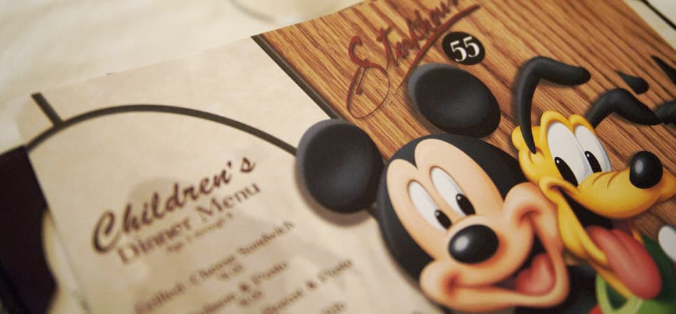 Mickey Mouse and Pluto appear on the children's menu.