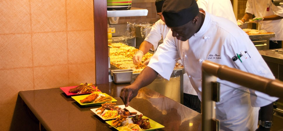 Chefs add the finishing touches to a dish.