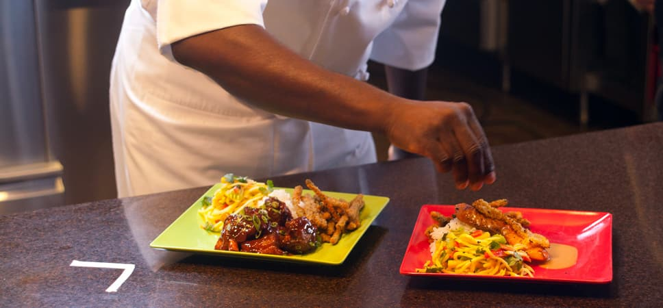 Chefs at Tangaroa Terrace add the finishing touches to a dish.