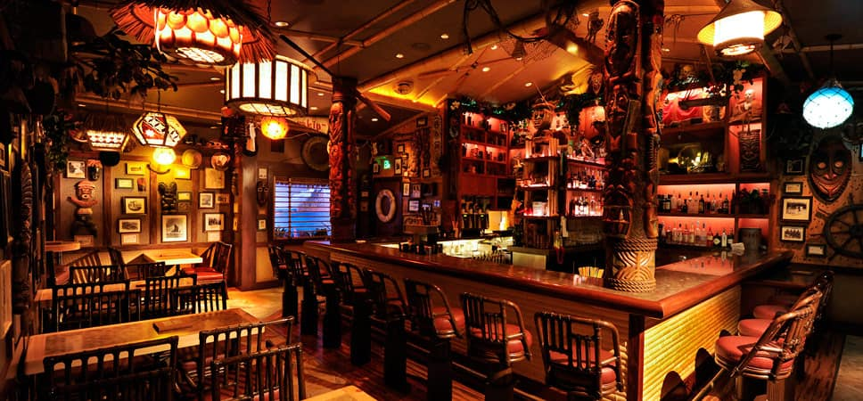 Warm lighting, tiki carvings, and plenty of treasures and trinkets fill this spectacular space.