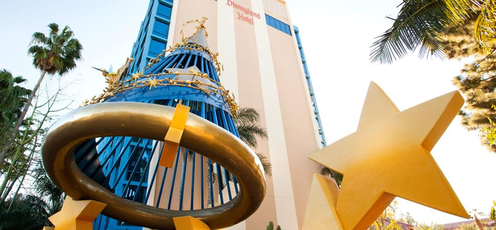 Looking up a Disneyland Hotel Tower with a large Sorcerer's Hat and stars in the foreground
