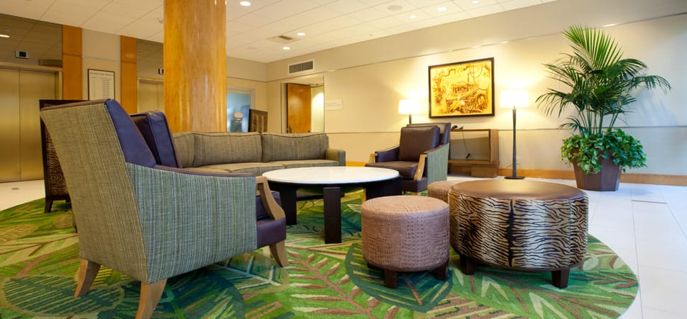 A couch, chairs and table arranged for conversation in the Adventure Tower lobby