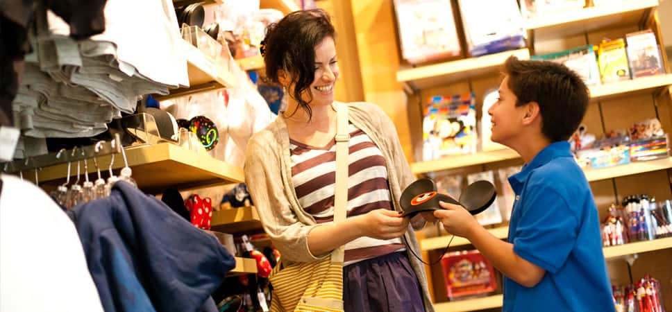 Inside the Small World Gifts & Sundries shop, a boy asks him mom to buy him a pair of Mickey ears.