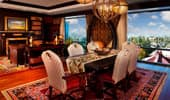 A dining table in the middle of luxurious adventurer's living area.