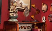 Decorative Suite pieces, like mounted butterflies and carved masks.