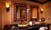 Stone-work sinks and mirrors in African-themed art frames.