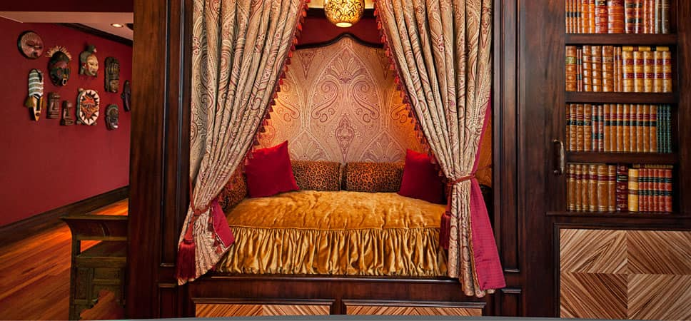 A plush and velvety reading nook with leopard print pillows.