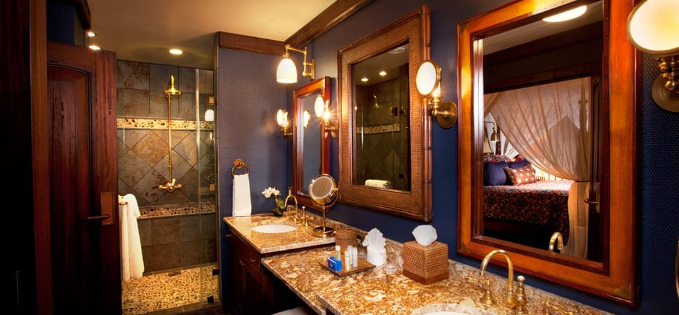 Elegantly designed master bathroom in blues, golds and warm woods.