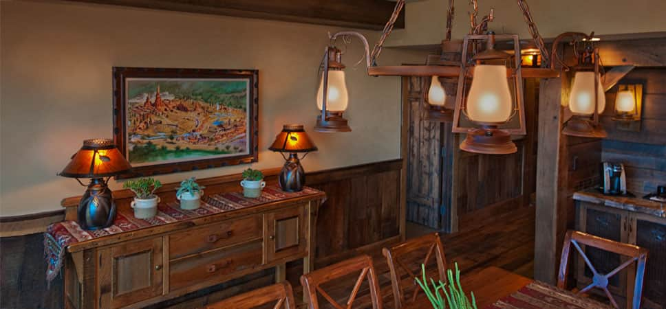 Wood paneling and a chandelier made from miner's lamps.