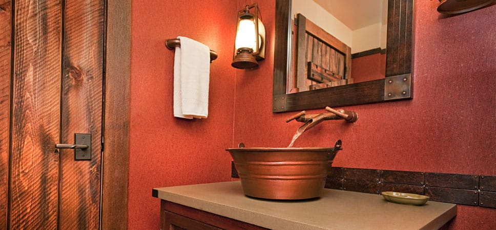 A copper-finished tub doubles as a sink.