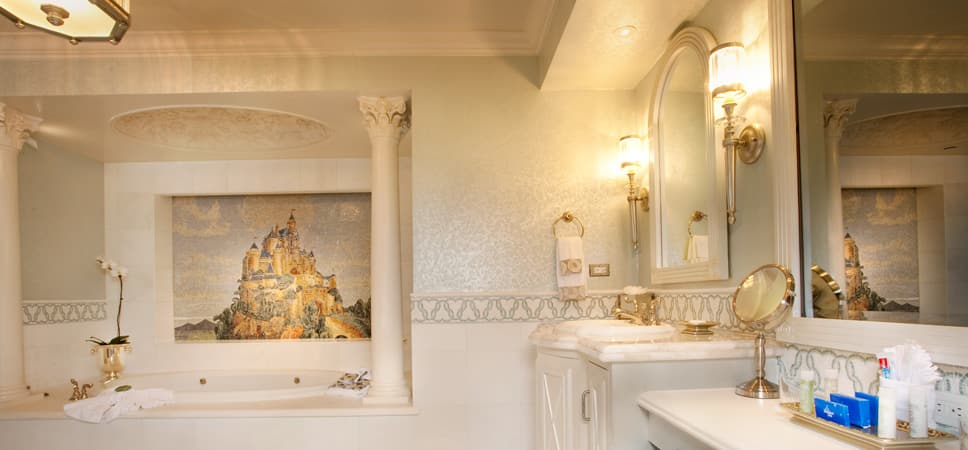 Wide shot of the white and gold bath, and mosaic feature.
