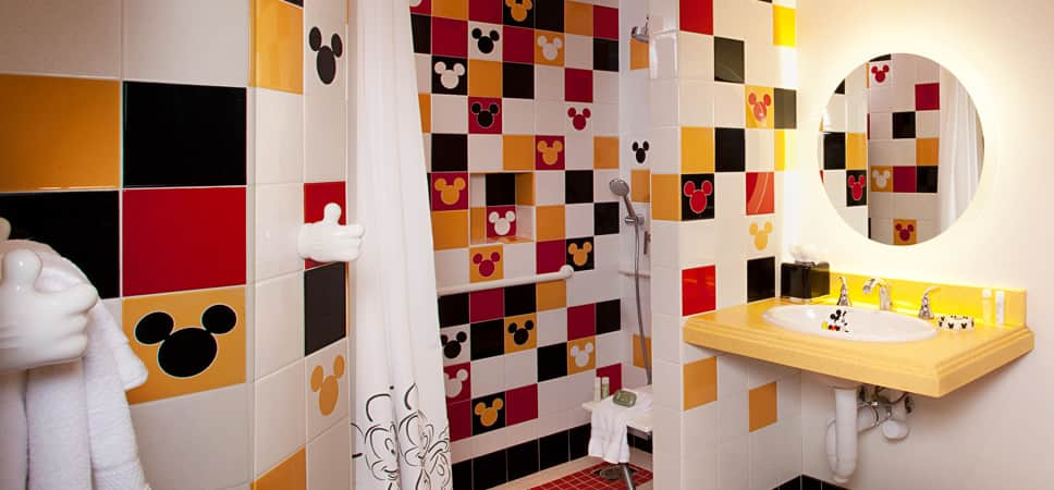 The additional bathroom is done in the colors that define Mickey Mouse.