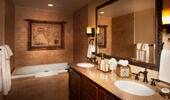 Vanity and tub in natural colors.