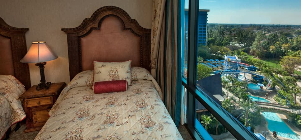 Beds near a large window with a post-card view.