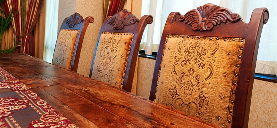 Close up on upholstered dining chairs.