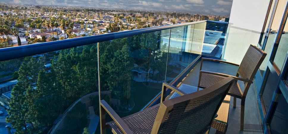 Chairs on a balcony offer an elevated view of the Disneyland Resort.