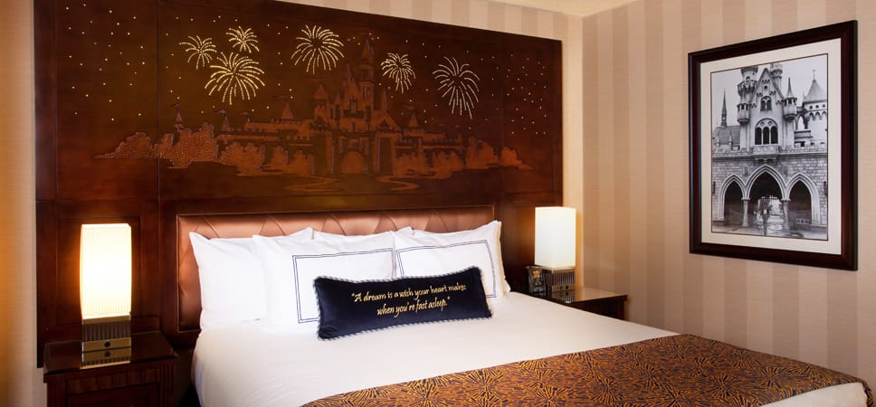 Disney fairy tale touches, like wood headboard, stitched pillow and framed photos, are found in each room.