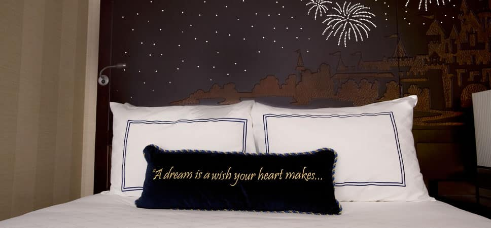 Disney fairy tale touches, like carved headboards and stitched pillows, are found in each room.