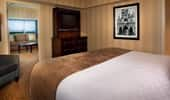One-Bedroom Suite with king bed and now-famous framed photo of Walt Disney.