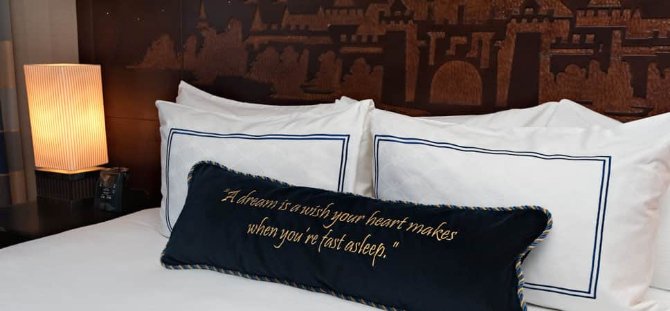 Disney fairy tale touches, like carved headboards and stitched pillows, decorate each room.