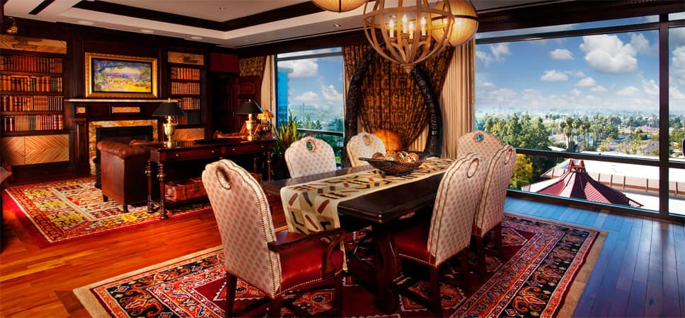 A dining table in the middle of spectacular adventurer's living area.
