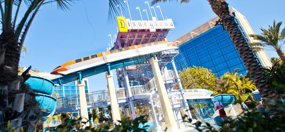 Water slides, play area and retro Disneyland sign at the Disneyland Hotel Monorail Pool.