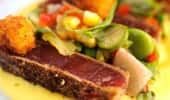 Close up of seared and crusted ahi tuna steak and sides.