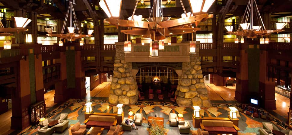 Wide shot of the lobby with the fireplace in the center of the frame.