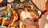 A family of 4 enjoys poolside service inside the rented cabana