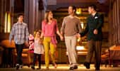 A family of 4 enjoys a guided tour of Disney's Californian Hotel & Spa.