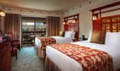 2 queen-size beds and luxurious surroundings in the 3-bedroom Artisan Suite