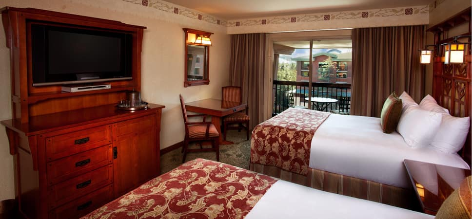 From the queen-size beds see the TV, dresser and exit to balcony.