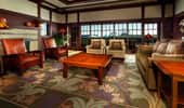 Couches and chairs surround an elegant carpet in the living area of the Mount Whitney Signature Suite.