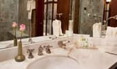 The white marble sink, stocked with Disney Resort's ~H2O+ Spa products