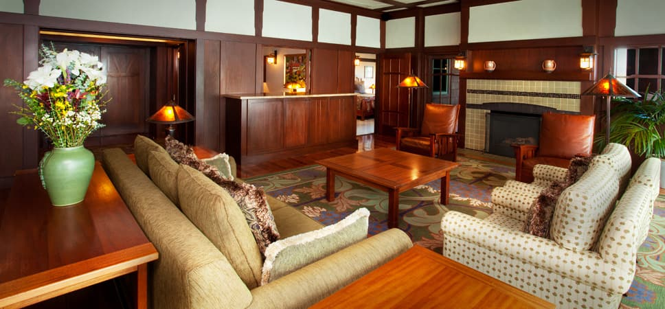 Plush couches and arm chairs in the living area of the Suite