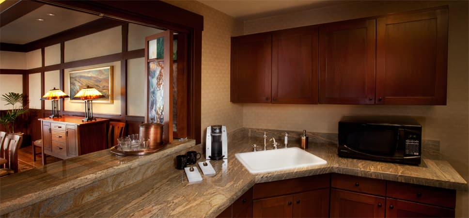 The wet bar provides a coffee maker, a microwave and plenty of cabinet space stocked with cups and plates.